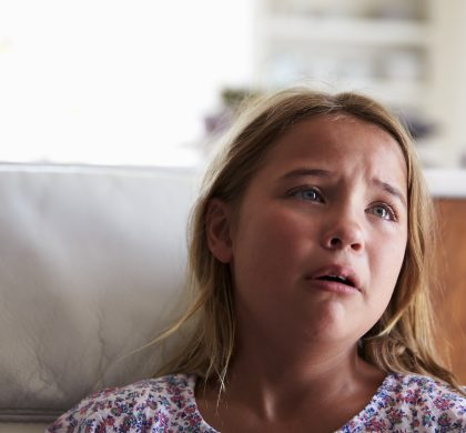 Head And Shoulders Shot Of Upset Girl At Home
